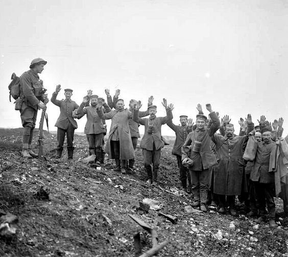 german prisoners of war with arms up in surrender