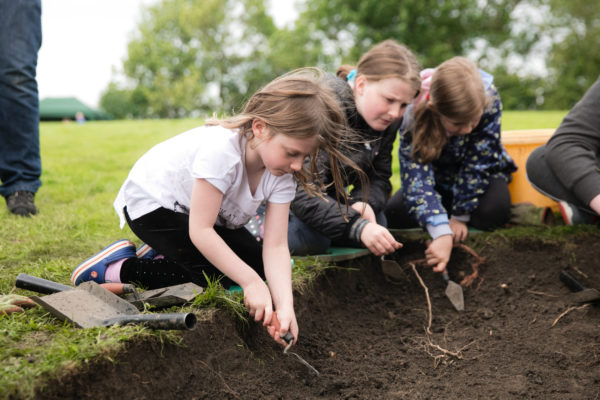 Photo of children digging during archaeology open day